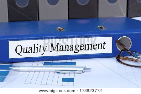 Quality Management - blue binder on desk in the office