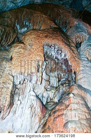 stalactites and stalagmites in rescherah Slovakia, a variety of colors and shades, black, orange, white, blue, beautiful nature, natural