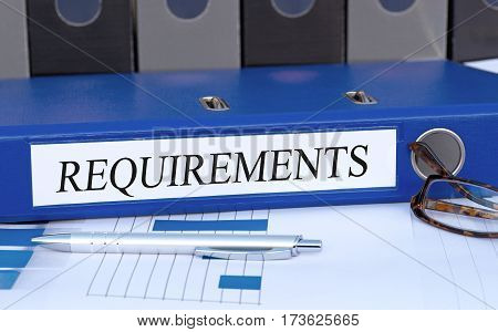 Requirements - blue binder on desk in the office
