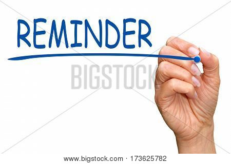 Reminder - female hand with blue marker writing text on white background