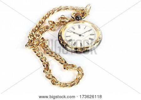 Pocket antique clock in the case of gold and metal chain for attaching to clothing