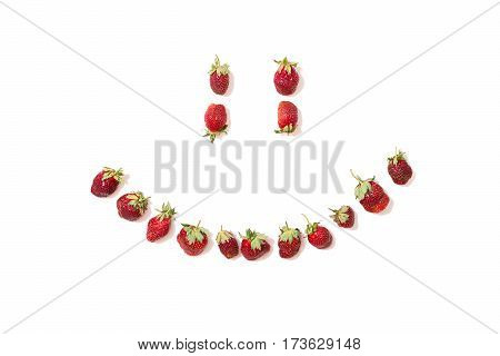Red ripe strawberries isolated on white background. Summer berries. Smile Smiley. Conceptual photography. Smile concept