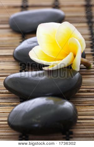 Spa Stones With Frangipani On Mat
