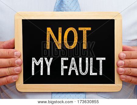 Not my fault - Businessman holding chalkboard with text