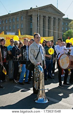 Volgograd Russia - May 01 2012: Musician with trumpet takes part in the May day demonstration in Volgograd