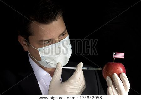 Young Businessman Injecting Chemicals Into An Apple With Liberian Flag On Black Background