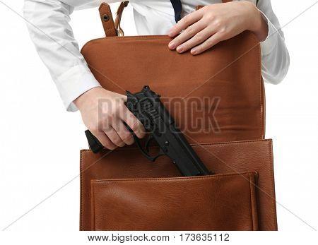 Schoolgirl hiding gun in bag on white background