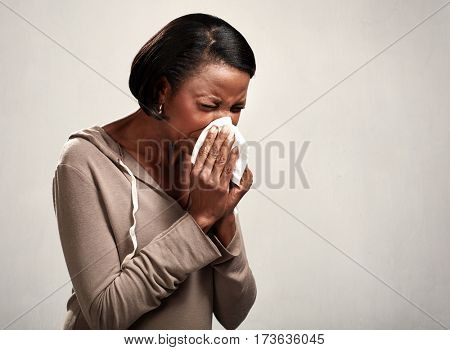 sneezing black woman