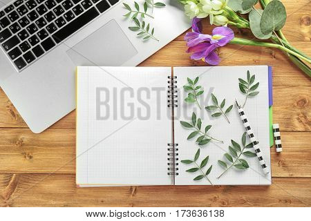 Green leaves on opened notebook
