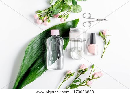oil and cream for nail care in spa on white background top view