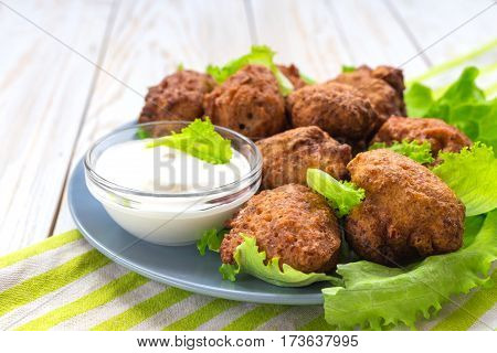 Acaraje Or Akara Snack With Green Salad And Sour Cream