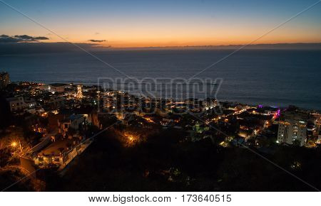 A look down onto downtown Puerto Vallarta from the viewing platform after sunset