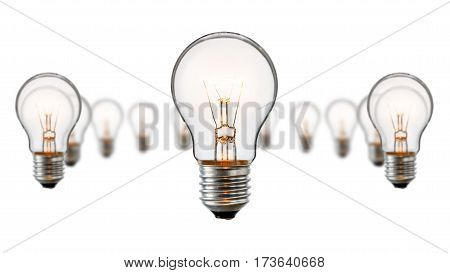 Realistic photo image of a turned on tungsten light bulbs isolated on a white background and with a clipping path for the middle one