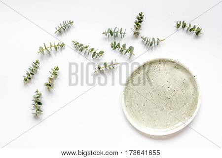 woman breakfast mockup in pastel color with lavander flowers and eucalyptus on white table background top view