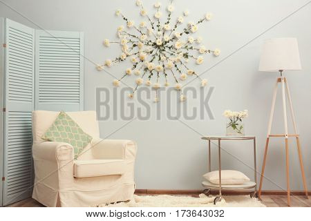 Modern room decorated with flower garland
