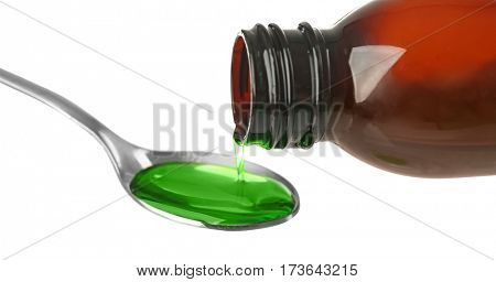 Pouring cough medicine syrup into spoon on white background