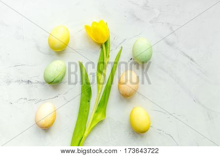 Easter concept eggs with tulip top view pattern.