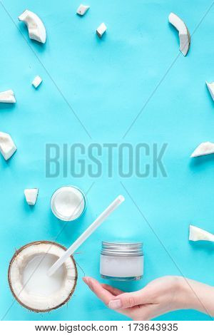 concept organic cosmetics with coconut on blue background top view.