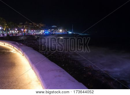 A night shot at the waters edge of the malecon in Puerto Vallarta