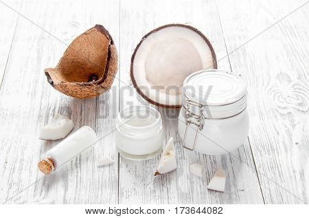 organic cosmetics with coconut on wooden background close up.