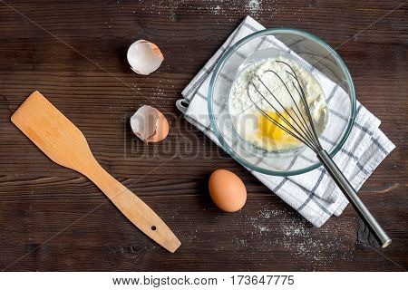 cooking pancake on wooden background top view ingredients for making .
