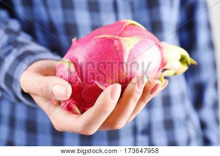 Woman holding dragon fruit
