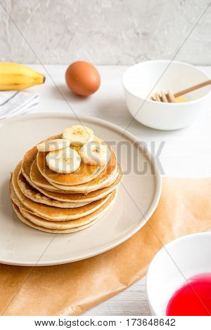 cooked pancake on plate at wooden background close up