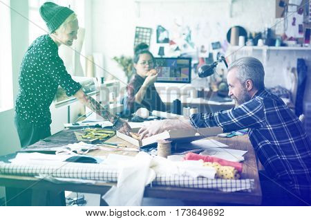 Group of fashion designer have pizza for lunch