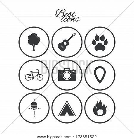 Tourism, camping icons. Fishing, fire and bike signs. Guitar music, photo camera and paw with clutches. Classic simple flat icons. Vector