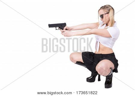 Sexy woman holding gun isolated on white background.