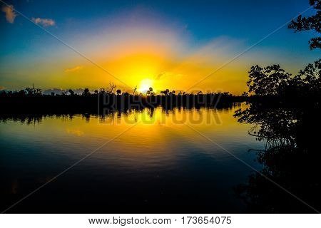 A wide angle view of the sunrising over the Florida Intracoastal Waterway