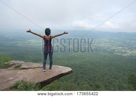 Independent living, Woman standing on a cliff