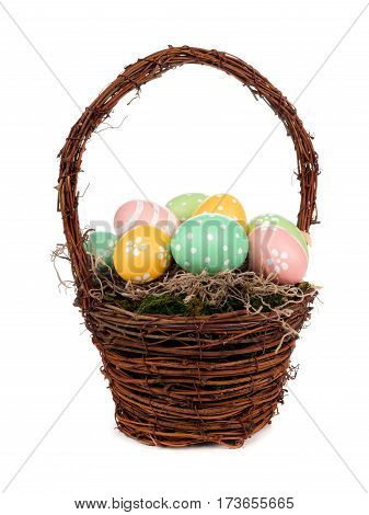 Easter Basket Filled With Hand Painted Easter Eggs Over A White Background