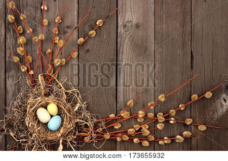 Spring Nest Corner Border With Willow Branches Over A Rustic Wooden Background