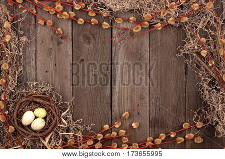 Spring Nest Frame With Willow Branches Over A Rustic Wooden Background