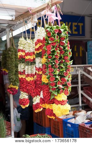 Flowers for offering to the gods hunging on market stole