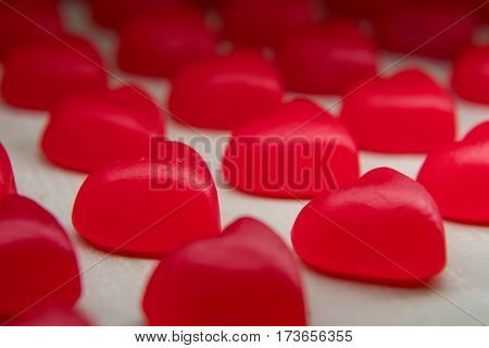 Focus on Second Row in Line of Gummy Hearts from low angle
