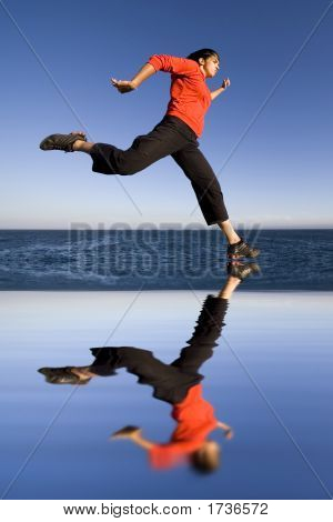 Sports Woman Jumping Over Water