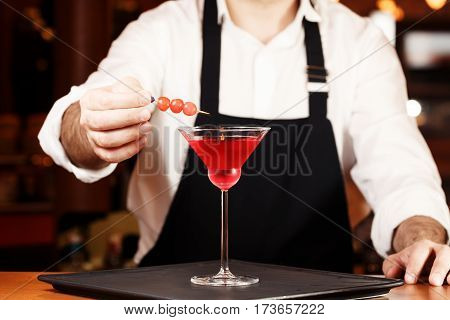Barman In Making Cocktail At A Nightclub. Nightlife Concept. No Face. Decorating Drink