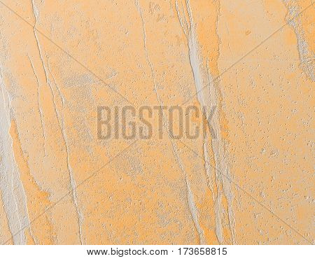 Grungy stone texture background. Abstract yellow background.