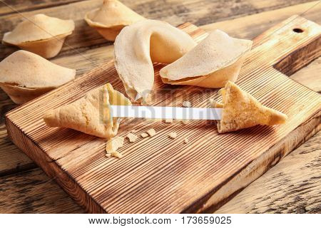 Fortune cookies on wooden cutting board