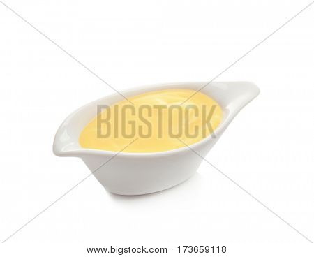 Sauceboat full of creamy cheese, isolated on white