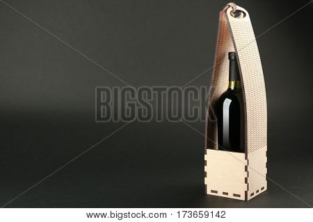 St. Valentine's Day concept. Wine bottle in gift box on dark background
