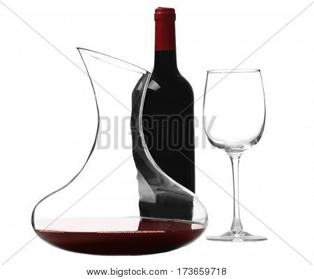 Glass carafe of red wine on white background