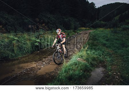 The young man cycling Cross-country in outdoor