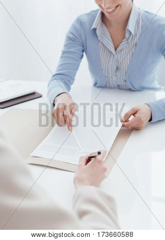 Customer Signing A Contract