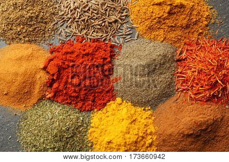 Heaps of various spices on table