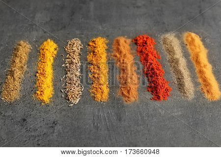 Lines of various spices on table