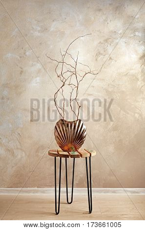 Decor in a vase on a color background
