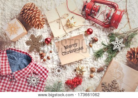 Christmas decorations and wish card on soft fabric background